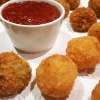 Arancini balls with spicy tomato relish